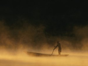 chris-johns-night-fisherman-in-a-dugout-canoe-on-the-zambezi-river